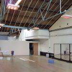 Quartz halogen heaters heating a sporadically used dance school