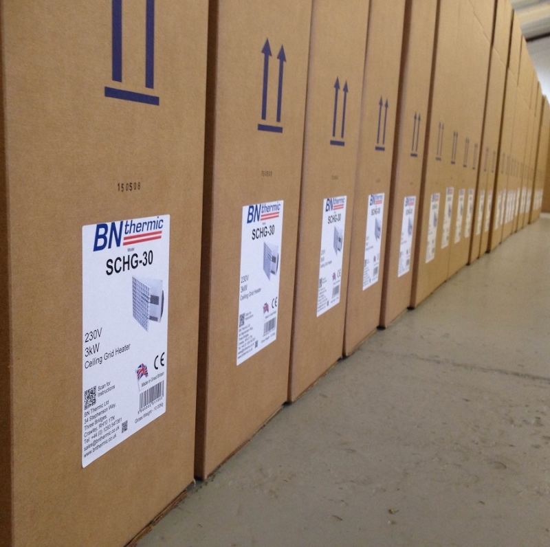 A batch of SCHG -30s being tested then boxed and ready for dispatch.