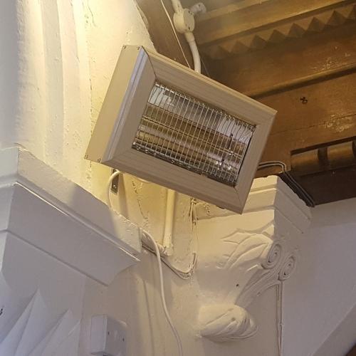 Quartz halogen heaters were installed behind an arch to heat the chancel