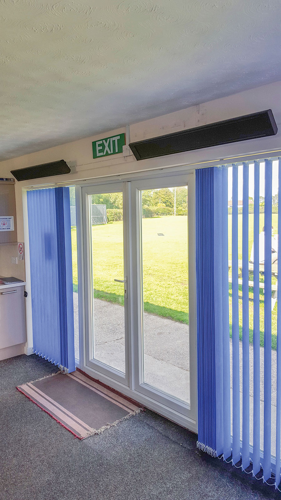 Terrace heaters installed indoors in a Norfolk sports club