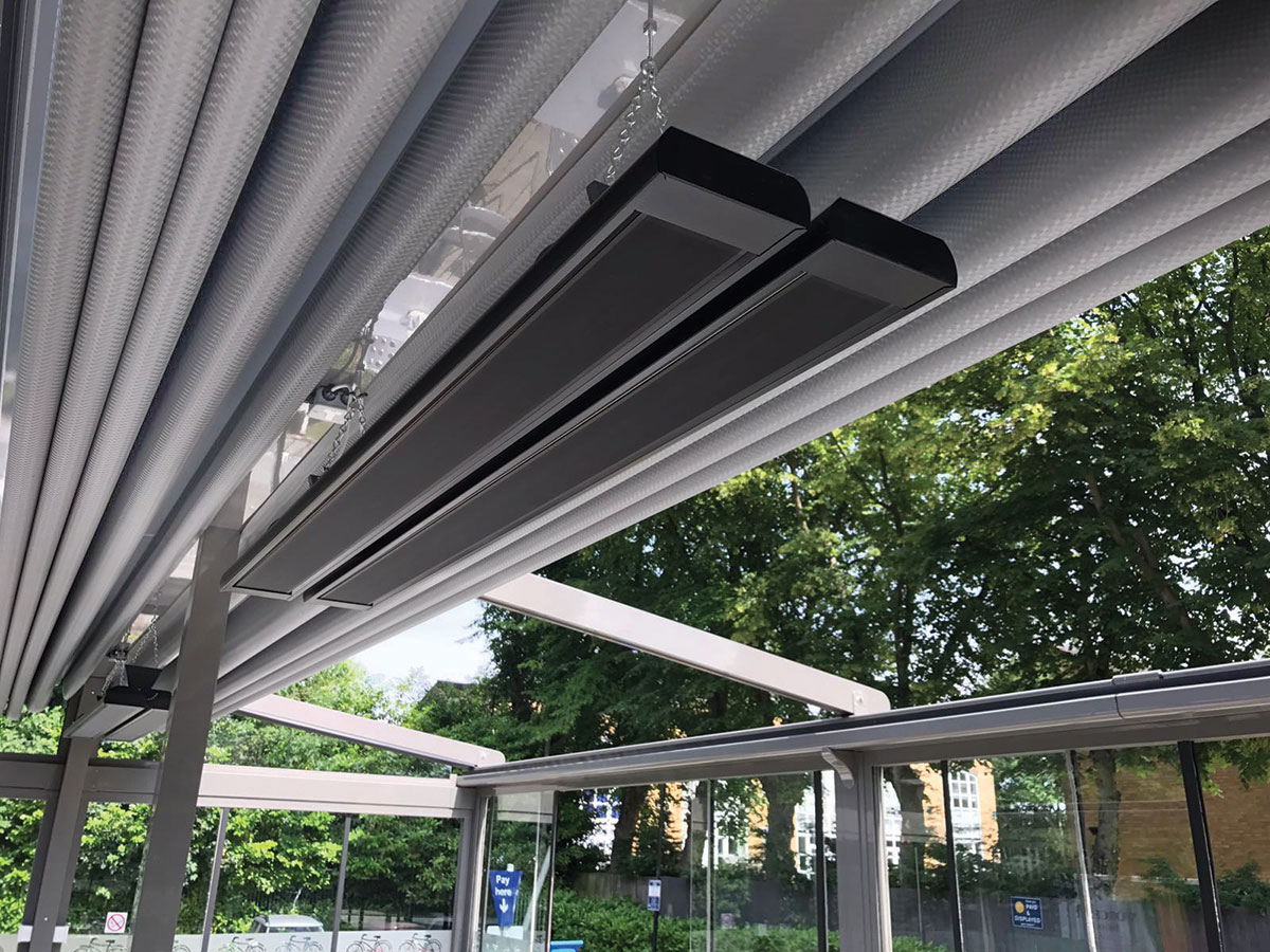 Two terrace heaters suspended using a ETH-B2 bracket in a sheltered dining area