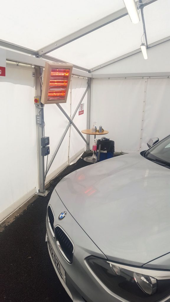 4.5kW halogen heater providing instant controllable heat in a car valeting tent