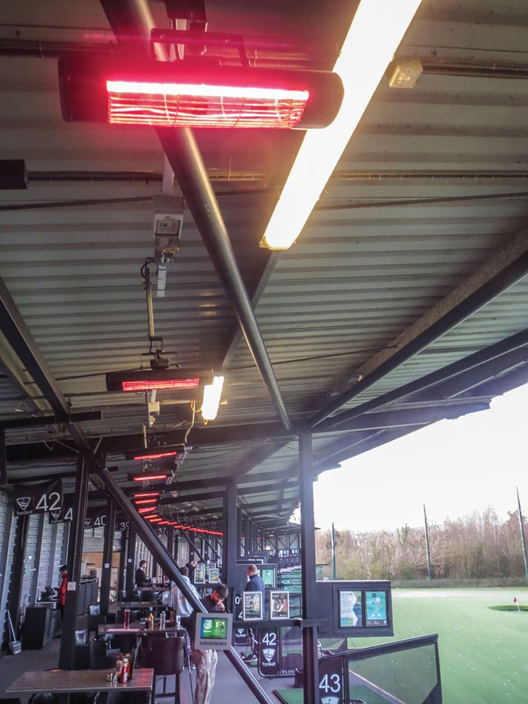 2kW patio heaters keeping golfers warm at a driving range
