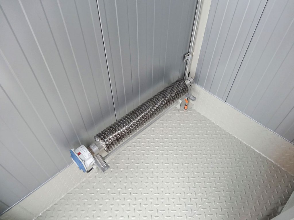 An SWD heater floor mounted using the brackets provided